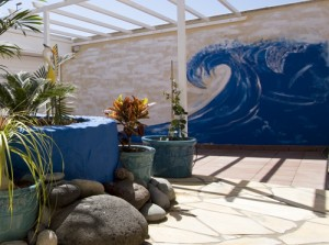 Mural of wave on Nikki's garden wall